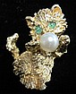 14 karat yellow gold 'cat' pin with pearl, , Emerald set 'eyes' and cultured pearl accent.