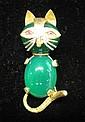 18 karat yellow gold 'cat' pin, , Ruby 'eyes' and green stone body.