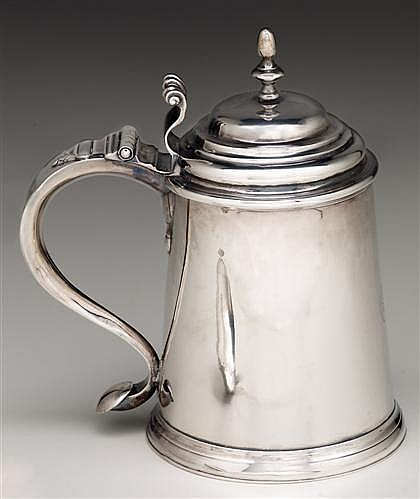 Sterling tankard, 18th century, Slender egg and urn form finial to domical lid with reed and scrolled thumb grip, plain flaring body wi