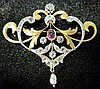 Platinum-topped 18 karat yellow gold diamond, pink sapphire and pearl brooch, france, Scrolling form featuring gold and platinum accent