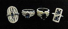 Group of four yellow and white gold, sapphire and diamond rings, , 18 karat white gold featuring oval cut sapphire accented by petite r