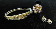 Group of assorted 14 karat yellow gold, diamond and sapphire jewelry, , Bangle bracelet featuring textured and florentine finished gold