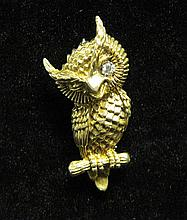 14 karat yellow gold and diamond 'owl' pin, Dan Frere, , Detailed polished and textured gold winking 'owl' accented by petite round cut