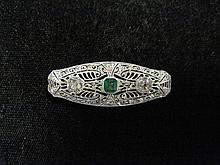 Art Deco platinum, diamond and emerald pin, , Center step cut emerald approximately 0.30 carats, featuring two old mine cut diamonds ap