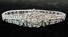 Art Deco platinum, diamond and emerald bracelet, , Center round cut diamond approximately 0.35 carats accented by petite round cut diam
