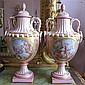 Pair of Sevres style porcelain pink ground jeweled enamel covered urns, late 19th/early 20th century, The pull-off domed cover surmount
