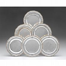 Six English silver dinner plates, London, various makers