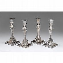 Four Sheffield silver-plated candlesticks, late 18th/early 19th century