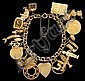 14 karat yellow gold charm bracelet, mid 20th century, Accented by charms of varying size, theme and karat.