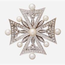 A diamond, cultured pearl, rhodium and fourteen karat white gold brooch,