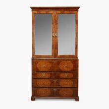 Fine William and Mary walnut, burlwood, and seaweed marquetry inlaid secretary bookcase, in the manner of Gerrit Jensen, early 18th...