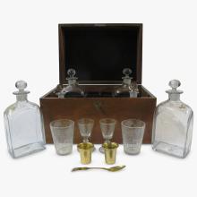 Assembled George III style brass mounted burl walnut and mahogany tantalus set, 19th century