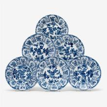 A set of six Chinese export blue and white scallop rimmed porcelain dishes with floral motifs, qi yu bao ding zhi zhen mark, kangxi...