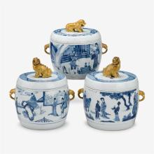 A pair of Chinese blue and white porcelain drum form lidded jars with gilded lion finials, pair with jiajing six character marks, ka...