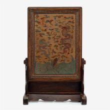 A large Chinese painted lacquer table screen showing flying dragons among clouds, qing dynasty