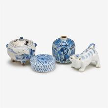 Three small Japanese blue and white glazed porcelain covered jars with one blue and white glaze porcelain tiger shaped water dropper...