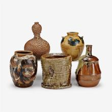 Five Japanese polychrome glazed earthenware jars of various form, meiji period and later