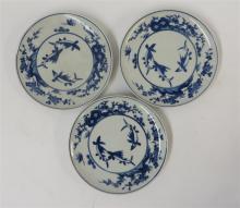 Three circular Japanese blue and white porcelain 'fish' plates, edo period