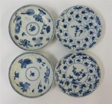 Four Chinese export style blue and white porcelain saucer dishes, kangxi period