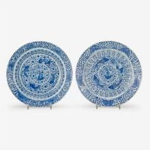 A pair of Chinese blue and white scalloped edge porcelain plates with fish design, four character kangxi mark and of the period