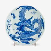 A small Chinese blue and white porcelain dragon plate, biding rui mark, kangxi period
