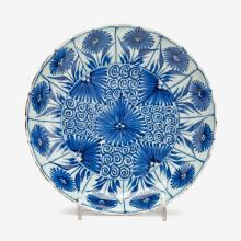 A Chinese blue and white floral decorated barbed rim porcelain dish, kangxi period