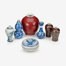 Six Chinese miniature porcelain vases and a blue and white porcelain paste box, 19th/20th century