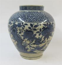 A Chinese Ming-style blue and white earthenware jar,
