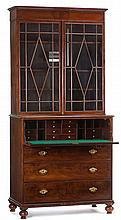 Regency mahogany secretary bookcase, early 19th century, In two parts: the upper section with reeded cornice over twin glazed cupboard
