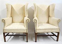 Pair of George III style mahogany wing back chairs, 19th century, The shaped crest flanked by outswept wings over trapezoidal seat and