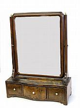 George II walnut dressing mirror, mid-18th century, The rectangular mirror plate enclosed in a molded frame, flanked by tapering suppor