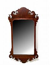 Chippendale mahogany looking glass of typical form with scrolled cresting and pediment, late 18th/early 19th century,