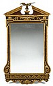 Fine George II parcel gilt mahogany mirror, 18th century, The broken pediment top centered by a cast eagle, the rectangular mirror plat