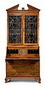 George III mahogany secretaire bookcase, 18th century, The molded cornice with fretwork frieze over twin astragal glazed cupboard doors