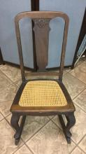 Antique cane bottom rocking chair
