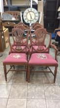 Antique wood chairs with different embroidered