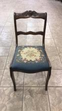 Wood carved chair with embroidered seat