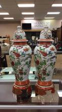Pair of oriental hand painted urns approximately