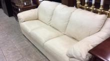 All leather cream colored sofa. In excellent