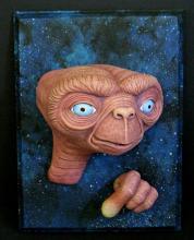 E.T. THE EXTRA TERRESTRIAL PAINTED PROTOTYPE RESIN PORTRAIT PLAQUE  Universal Studios, 1995. E.T. portrait plaque sculpted by Joe Laudati.A rare painted prototype sample of product later sold exclusivelyat Universal Studio Theme Park. Measures 9