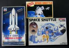 THREE VINTAGE JAPANESE SPACECRAFT PLASTIC MODEL KITS - Lot includesspace shuttle Columbia and rocket, and two whimsical space shuttle models. Complete, unbuilt, in box. Near mint.