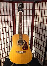 Epiphone masterbuilt acoustic guitar. This is a great guitar that is not electric.There is no cutaway.This guitar sounds great because of the rosewood back and sides