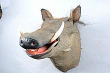A STUFFED AND MOUNTED WARTHOG HEAD