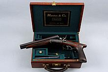 THOMAS BLAND & SONS A 20-BORE DOUBLE BARREL HAMMER