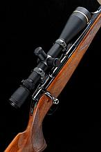 SAUER A 7X64MM SAUER 90 BOLT-ACTION SPORTING RIFLE, NO. K13558 20-inch barrel with ramp fore sight and raised rear sight, the receiver mounted with a Leupold 6.5-20x50 telescopic sight, quick detachable mounts, bolt with tang safety, detachable box