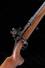 A MAUSER BASED 7.62MM TARGET RIFLE, NO. 1065 28-inch Schultz & Larsen barrel with tunnel fore sight, the receiver mounted with John Wilkes precision aperture rear sight, half length stock with pistol grip, cheekpiece and ribbed butt plate, 11lb.