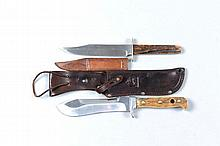 PUMA A PUMA WHITE HUNTER HUNTING KNIFE 6-inch polished steel blade, numbered 6377, stag horn grips, in its leather sheath; together with a Sheffield stag-handled hunting knife, the blade impressed '' W. Morton & Sons, Sheffield'' (2)