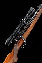 ALEX HENRY & CO. A 7X57 BOLT-ACTION SPORTING RIFLE, NO. 743 23 1/2-inch replacement barrel with raised fore sight and folding leaf sight, fitted by Thompson & Campbell Ltd, the receiver mounted with a Pecar 4x81 telescopic sight, bolt with flag