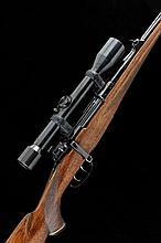 ORBIS A .243 BOLT-ACTION SPORTING RIFLE, NO. 14043 23 1/2-inch barrel with ramp fore sight and raised rear sight, the Mauser 98 receiver mounted with a vintage Zeiss Zielsechs telescopic sight, bolt with flag safety, double set triggers, the half