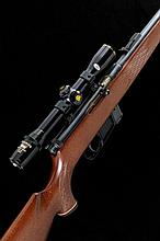 VOERE A .22 SELF-LOADING RIFLE, NO. 210313 21-inch barrel with tangent rear sight, fore sight removed, the receiver mounted with a Nikko Sterling telescopic sight, detachable box magazine, half length stock with pistol grip and cheekpiece, 14-inch